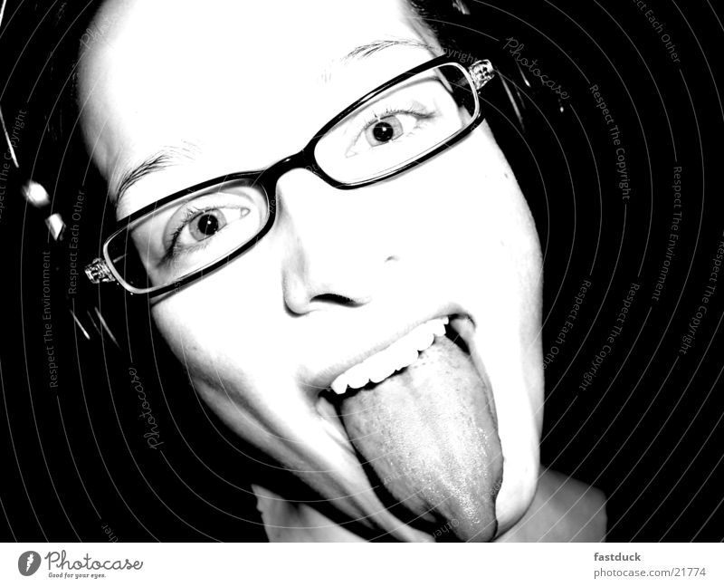 Woman White Joy Black Feminine Emotions Teeth Eyeglasses Facial expression Headphones Tongue