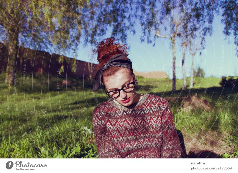 Young and redhead bored student Lifestyle Human being Feminine Young woman Youth (Young adults) 1 18 - 30 years Adults Environment Nature Grass Park Sweater