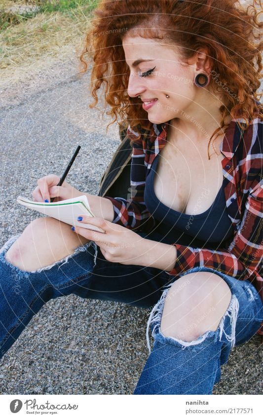 Young redhead woman writing in a notebook Human being Youth (Young adults) Young woman Beautiful 18 - 30 years Adults Lifestyle Feminine Style Smiling Happiness