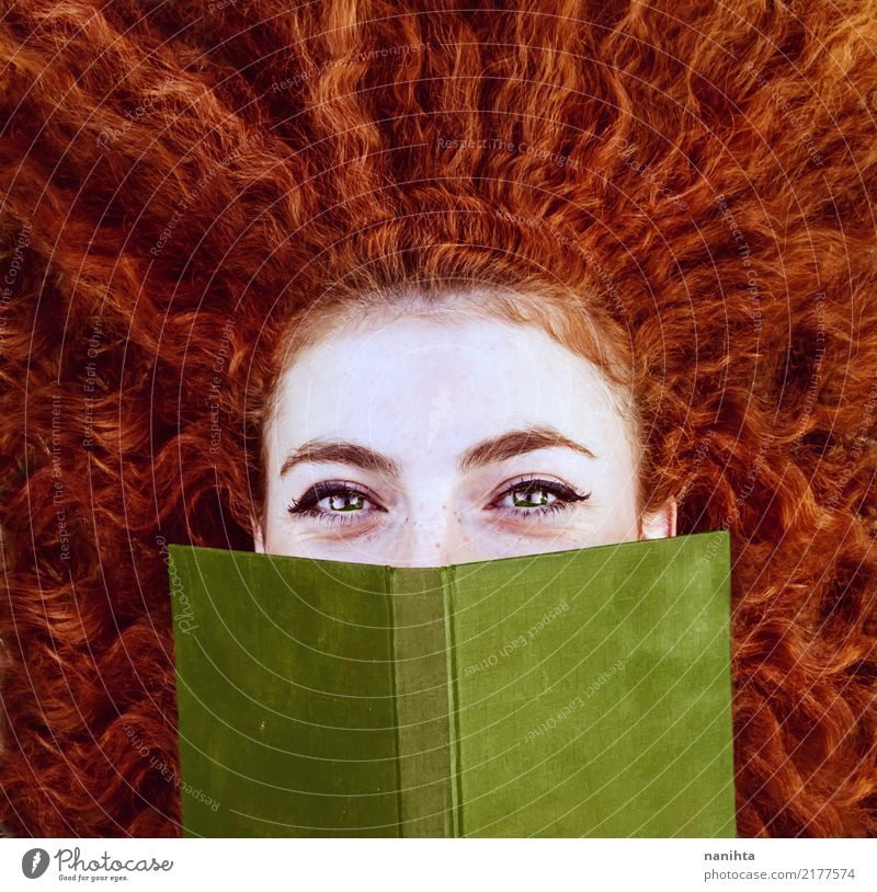 Redhead young woman covering by a red book Lifestyle Beautiful Face Freckles Study Human being Feminine Young woman Youth (Young adults) 1 18 - 30 years Adults