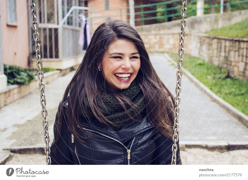 Young and happy woman in a swing Human being Youth (Young adults) Young woman Town Beautiful Joy 18 - 30 years Adults Life Lifestyle Feminine Style Laughter