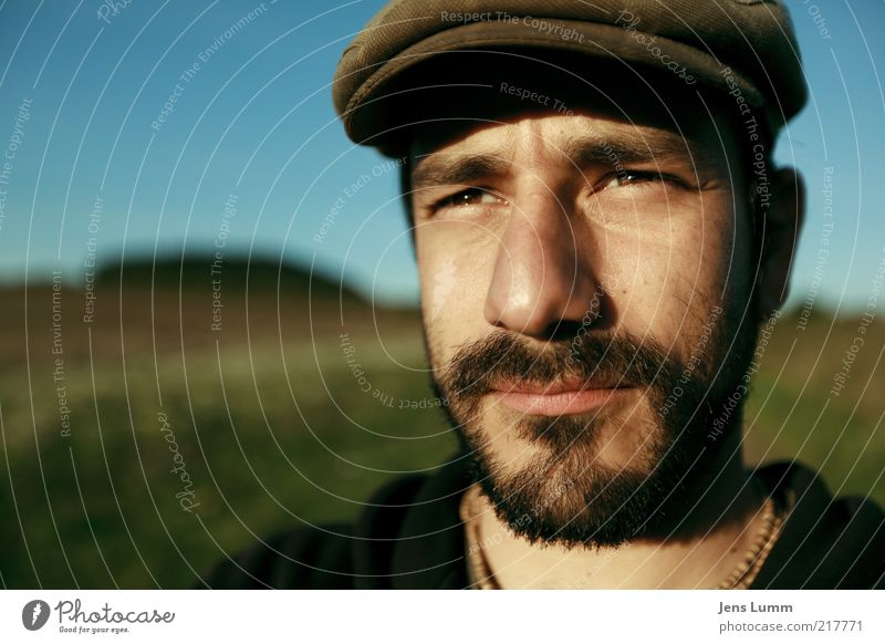 Human being Sky Green Blue Eyes Far-off places Meadow Brown Nose Masculine Facial hair Meditative Cap Dazzle Beautiful weather Blue sky