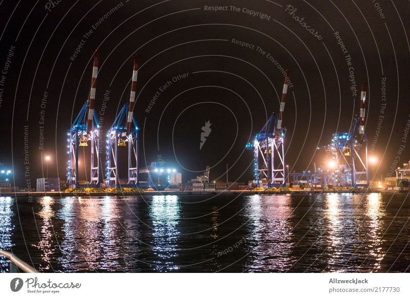 Cranes in the port of Genoa Italy Europe Genua Port City Harbour Container terminal Deserted Apartment Building Lighting Night Lamp Illuminate Water