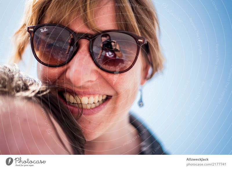 Woman with sunglasses laughing happily 2 people Day Young woman Happy Joy Contentment Love Sunglasses Head Portrait photograph Laughter Smiling Cloudless sky