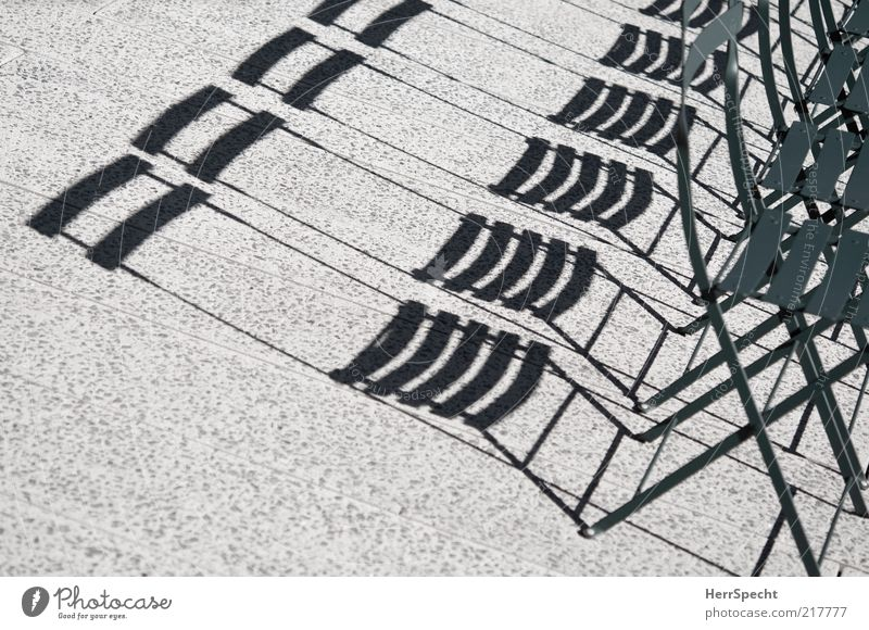 Shady places still available Chair Concrete Metal Gray Green Folding chair Shadow play Colour photo Subdued colour Exterior shot Pattern Structures and shapes