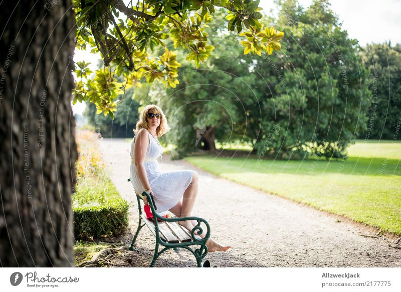 In park 1 Relaxation Calm Vacation & Travel Trip Freedom Summer Summer vacation Sun Sunbathing Feminine Woman Adults Human being Beautiful weather Tree Garden