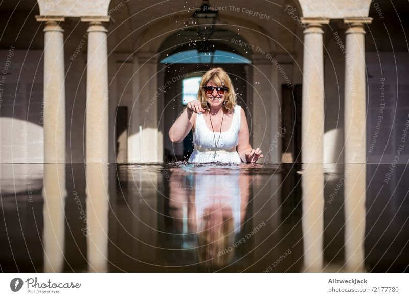 Woman with sunglasses plays with water Day 1 Person Feminine Young woman Blonde Long-haired Dress Water Well Basin Refreshment Summer Sunglasses Column
