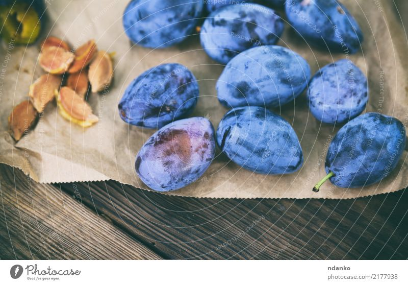 ripe blue plums Nature Blue Summer Eating Natural Wood Group Fruit Nutrition Fresh Table Paper Delicious Vegetarian diet Diet Juicy