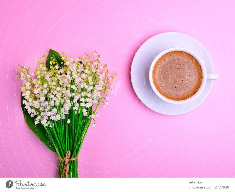 cup of black coffee Breakfast To have a coffee Hot drink Coffee Cup Mug Flower Bouquet Green Black White Lily of the valley Top stem Saucer Porcelain blooming