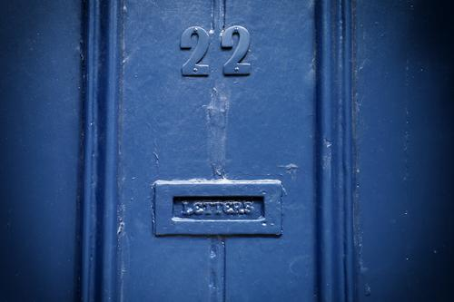 22 LETTERS. Great Britain House (Residential Structure) Door Name plate Mailbox Wood Digits and numbers Blue England Yorkshire Colour photo Exterior shot