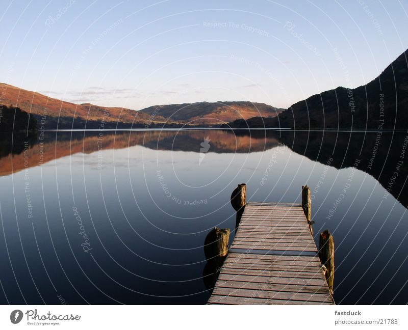 in the morning 8:05 am Lake Reflection England Great Britain Lake District National Park Ullswater Red Footbridge Water Mountain Blue