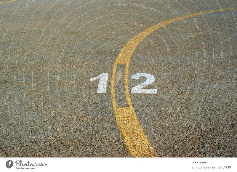 12 Sign Digits and numbers Yellow Gray White Stripe Concrete Concrete floor Colour photo Subdued colour Exterior shot Deserted Copy Space left Copy Space right