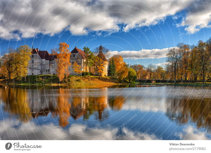 Ancient castle by the lake in autumn Sky Nature Vacation & Travel Old Blue Beautiful White Tree Landscape Red Winter Architecture Autumn Building Tourism Lake