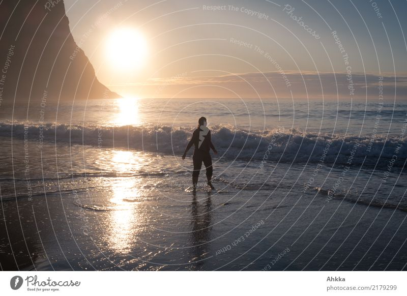 Young woman in the North Sea at sunset Harmonious Well-being Contentment Senses Relaxation Vacation & Travel Summer vacation Beach Ocean Waves