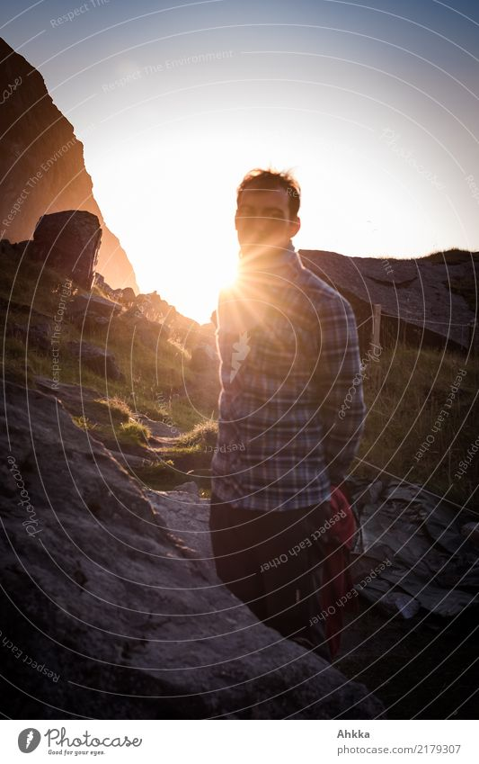 Young man with lumberjack shirt at sunset in Norway Harmonious Well-being Senses Calm Vacation & Travel Adventure Far-off places Freedom Summer Summer vacation