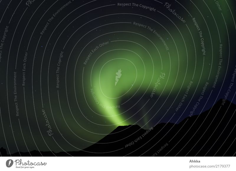 Northern lights before mountain silhouette Night sky Stars Aurora Borealis Mountain Norway Esthetic Authentic Exceptional Dark Exotic Fantastic Gigantic Wild