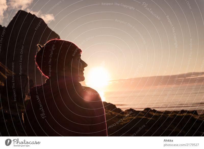 Young woman enjoying sunset in Lofoten Harmonious Well-being Contentment Senses Relaxation Calm Youth (Young adults) Horizon Sun Sunrise Sunset Mountain Coast