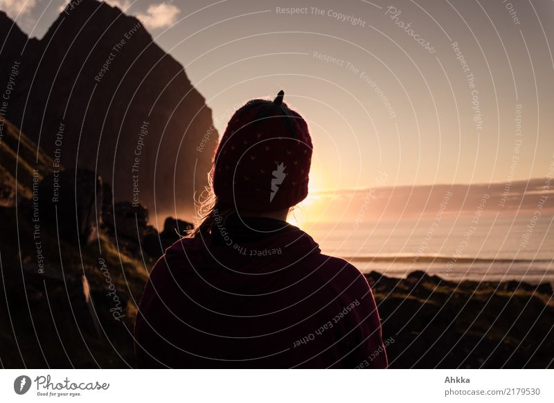 Young woman in strawberry cap enjoying sunset, Lofoten Harmonious Senses Relaxation Calm Meditation Vacation & Travel Far-off places Youth (Young adults) 1