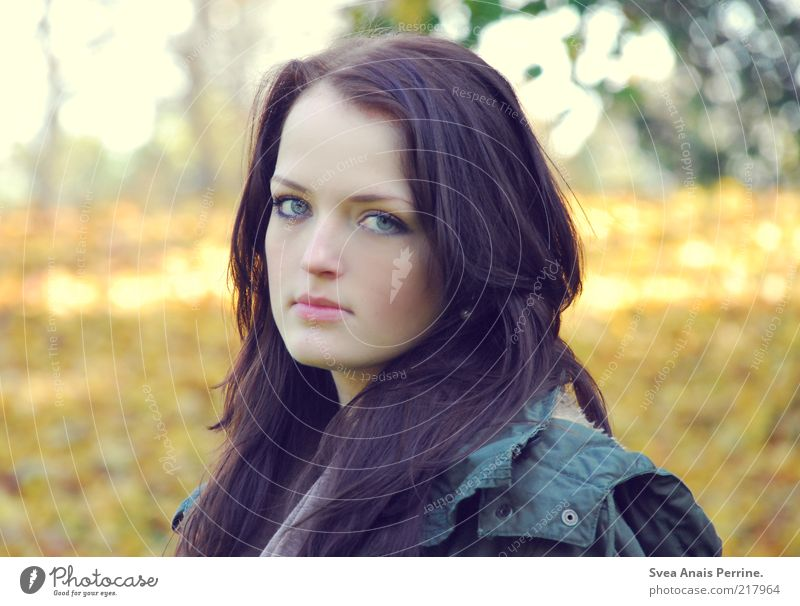 skeptical. Elegant Feminine Young woman Youth (Young adults) Hair and hairstyles Face 1 Human being 18 - 30 years Adults Autumn Jacket Observe Looking Wait