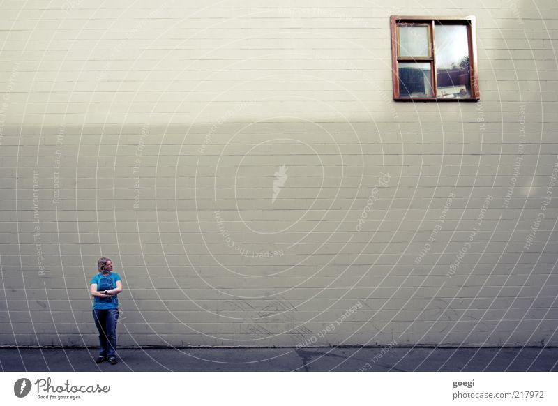 Human being Woman Loneliness House (Residential Structure) Adults Window Wall (building) Wall (barrier) Building Think Blonde Facade T-shirt Observe Jeans