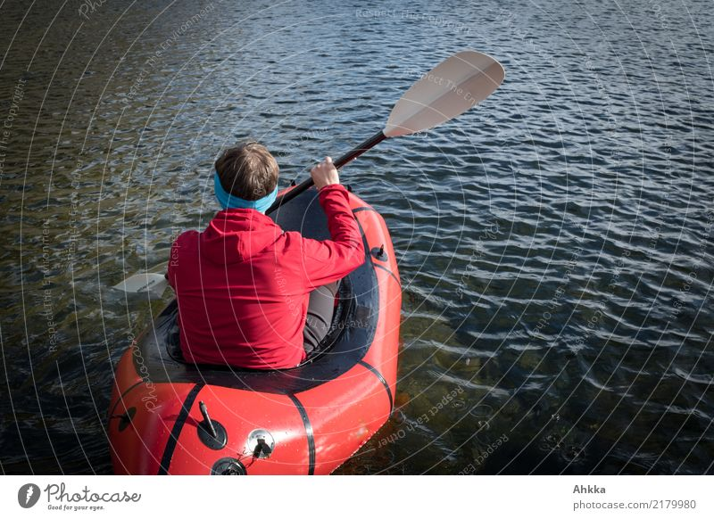 Young man in a red boat on a lake, Norway Adventure Aquatics Education Science & Research Youth (Young adults) 1 Human being Nature Water Spring Summer Lake