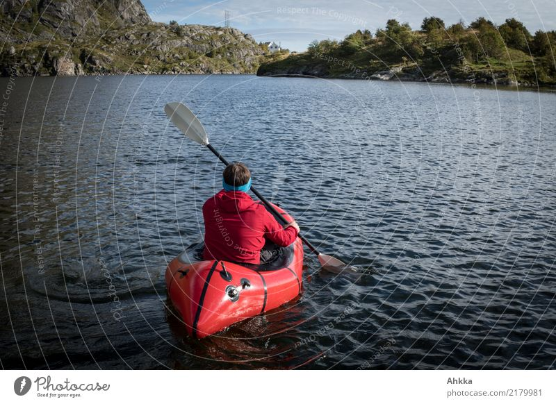 Red paddler on a Norwegian mountain lake Life Vacation & Travel Trip Adventure Far-off places Freedom Aquatics Young man Youth (Young adults) Nature Elements
