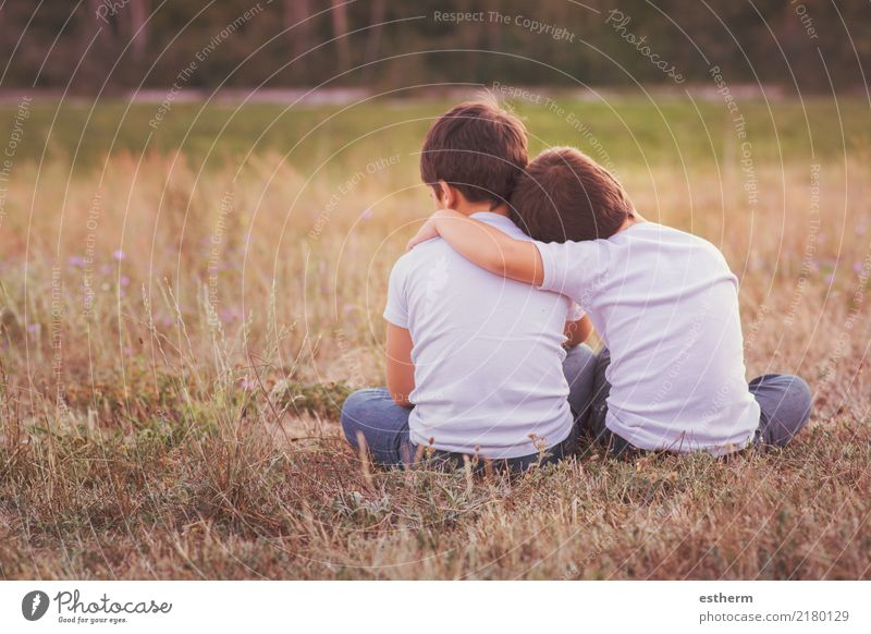 Brothers embracing in the field Child Human being Nature Vacation & Travel Lifestyle Love Emotions Meadow Boy (child) Family & Relations Together Friendship