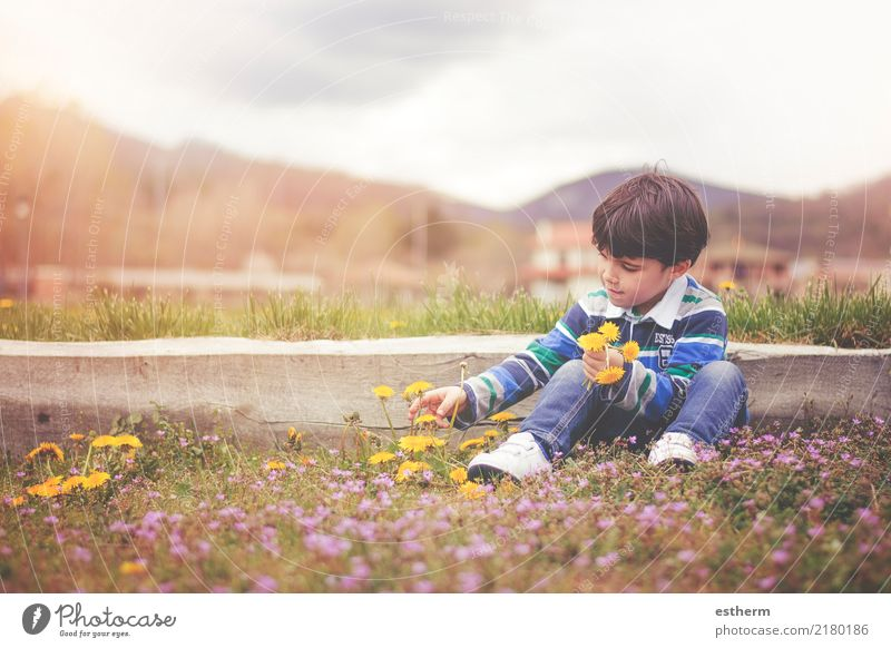 Happy child with flowers in spring Child Human being Nature Vacation & Travel Flower Joy Environment Spring Love Garden Freedom Masculine Park Field Infancy