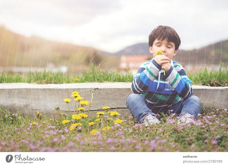 Happy child with flowers in spring Child Human being Nature Vacation & Travel Flower Relaxation Joy Lifestyle Spring Emotions Boy (child) Garden Freedom