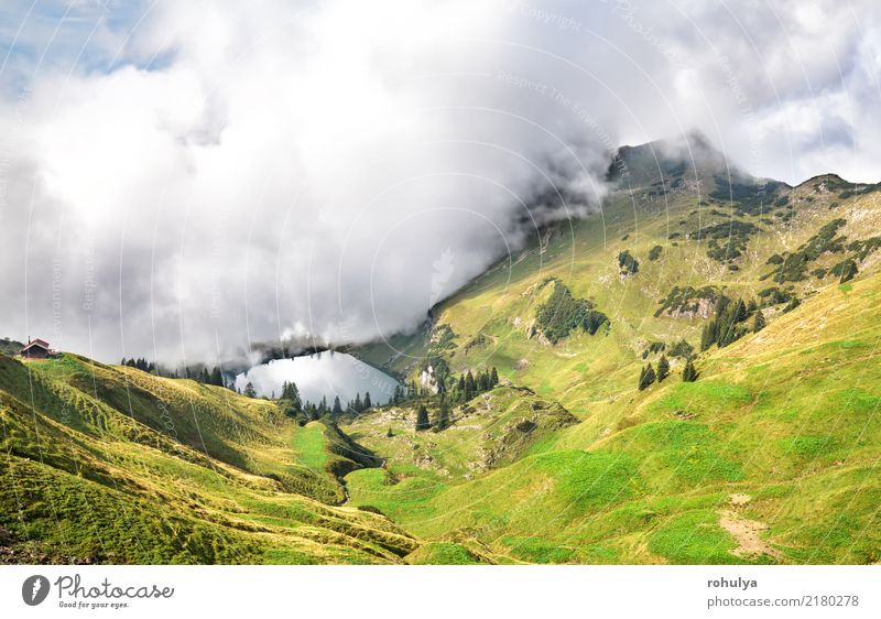 dense fog starts to cover alpine lake Seealpsee Vacation & Travel Mountain Hiking Nature Landscape Sky Clouds Summer Weather Beautiful weather Storm Fog Meadow