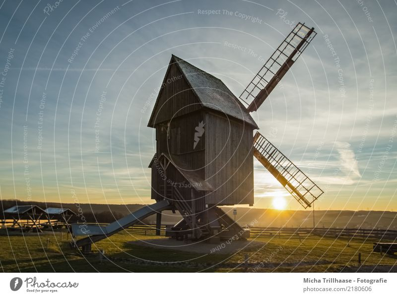 Windmill in the evening light Windmill vane Nature Landscape Sky Clouds Sun Sunrise Sunset Sunlight Weather Beautiful weather Plant Grass Manmade structures