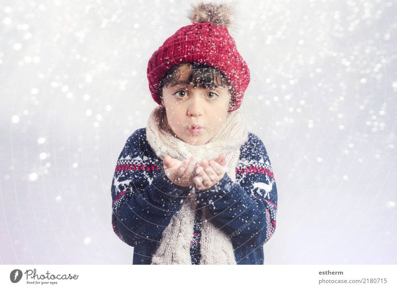 child blowing snow on christmas Lifestyle Joy Winter Snow Winter vacation Event Feasts & Celebrations Christmas & Advent New Year's Eve Human being Child