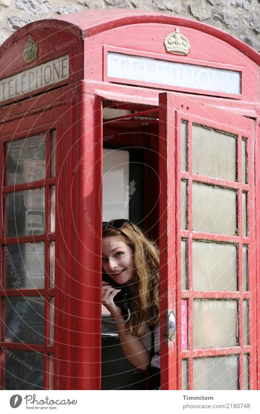 PULL. Vacation & Travel Telephone Human being Young woman Youth (Young adults) 1 Great Britain Phone box Metal Looking Red Joy Open Bright England Yorkshire