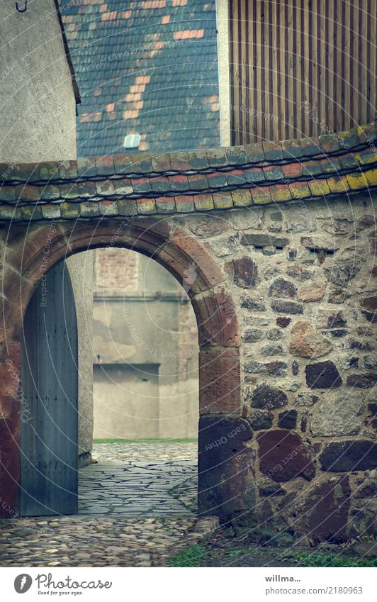 Wall (building) Building Wall (barrier) Historic Manmade structures Cobblestones Gate Rural Archway Courtyard Interior courtyard Medieval times Monastery