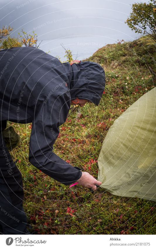 Young man struggles with a tent in storm and rain Vacation & Travel Adventure Far-off places Camping Youth (Young adults) Nature Elements Water Bad weather