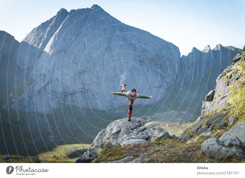 Young woman tries flying in Scandinavian mountain landscape Playing Vacation & Travel Adventure Far-off places Freedom Youth (Young adults) Nature Elements