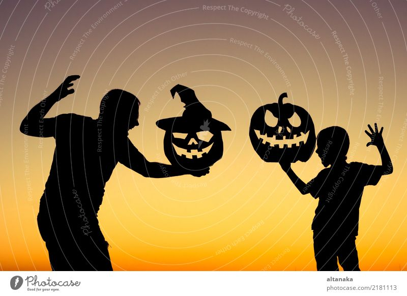 Happy father and son playing outdoors Lifestyle Joy Playing Vacation & Travel Summer Feasts & Celebrations Hallowe'en Child Boy (child) Man Adults Parents