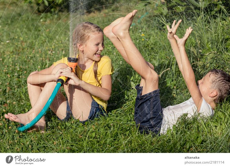 Happy kids sitting on the grass Joy Leisure and hobbies Playing Vacation & Travel Freedom Summer House (Residential Structure) Garden Child Boy (child)