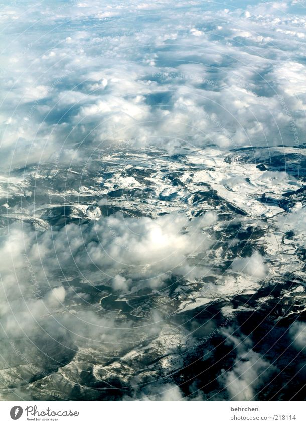 Sky Vacation & Travel Clouds Winter Far-off places Snow Freedom Mountain Landscape Environment Tourism Wanderlust Climate change Bird's-eye view Nature