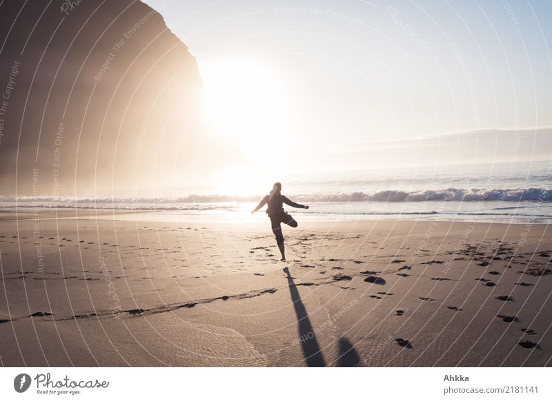 Young woman dancing on the beach in the sunset Playing Vacation & Travel Adventure Far-off places Freedom 1 Human being Nature Sun Mountain Waves Beach Ocean