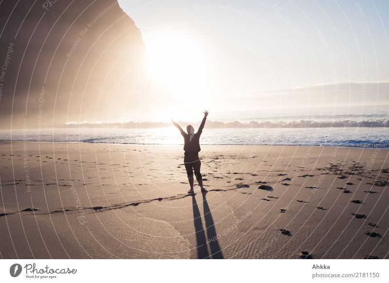 Young woman greets at the beach in the sunlight at the North Sea Life Harmonious Well-being Vacation & Travel Trip Adventure Youth (Young adults) Nature Sun