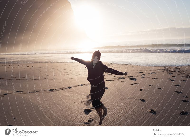 Beach pleasures, young woman at the northern sea in front of the sun Vacation & Travel Adventure Far-off places Summer Summer vacation Sun Ocean Waves