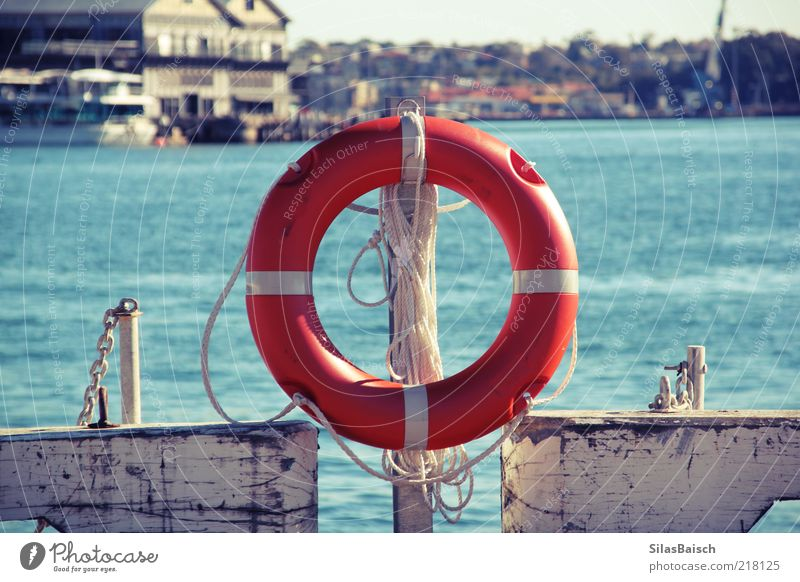 safe is safe Port City Navigation Watercraft Life belt Harbour Rope Circle Safety Colour photo Exterior shot Orange Jetty