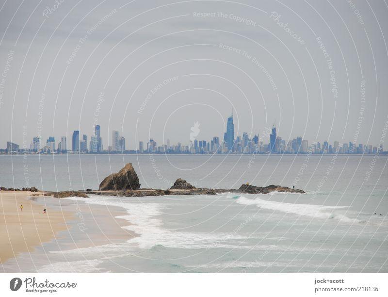 Sky City Ocean Calm Far-off places Environment Coast Building Stone Sand Horizon Growth Gloomy Modern High-rise Infinity