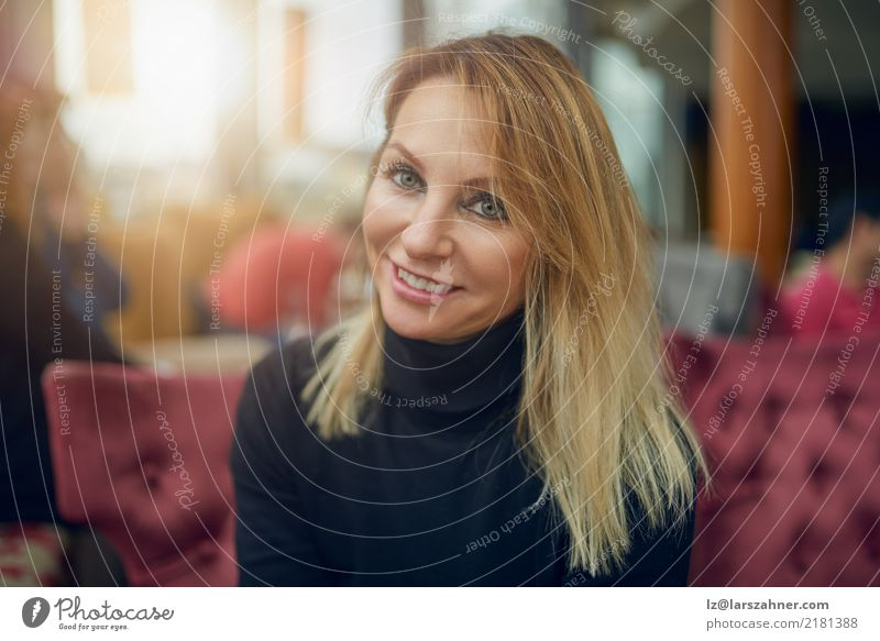 Attractive woman sitting in a restaurant Happy Face Restaurant Business PDA Woman Adults 1 Human being 30 - 45 years Fashion Scarf Blonde Smiling Sit Thin