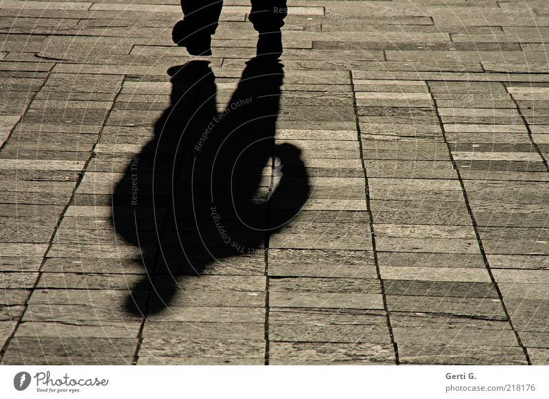 Human being Man Black Dark Movement Lanes & trails Stone Feet Arm Going Places Paving stone Paving tiles Dark side Stone slab