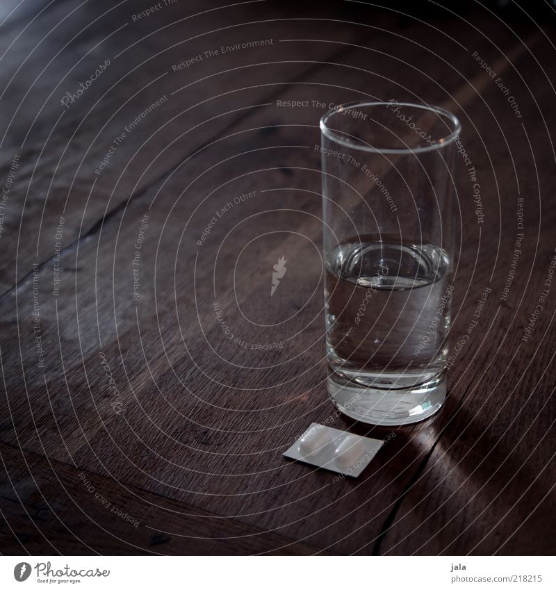 pain, let go! Beverage Drinking water Glass Table Wood Pain Pill Water Colour photo Subdued colour Interior shot Deserted Copy Space left Copy Space top