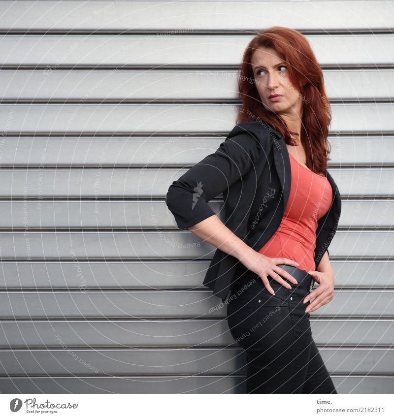 anja Feminine Woman Adults 1 Human being Wall (barrier) Wall (building) Rolling door T-shirt Pants Jacket Red-haired Long-haired Metal Observe Think To hold on