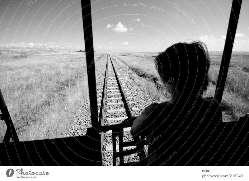 Human being Child Summer Vacation & Travel Black Clouds Loneliness Far-off places Boy (child) Meadow Grass Freedom Gray Dream Masculine Railroad