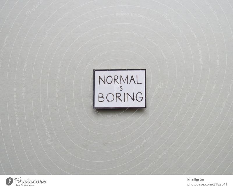 NORMAL IS BORING Characters Signs and labeling Communicate Sharp-edged Gray Black White Emotions Boredom Colour photo Studio shot Deserted Copy Space left